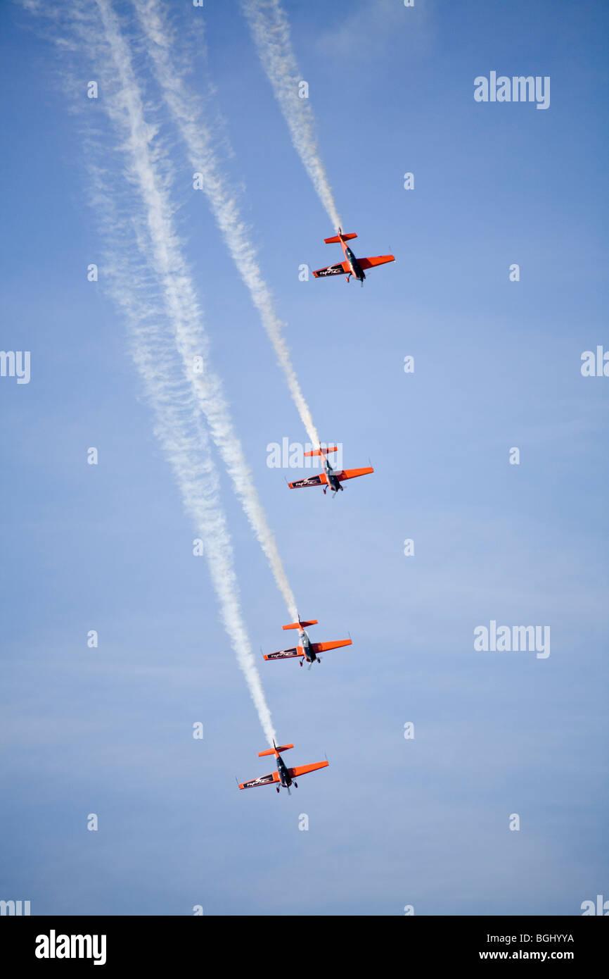 Blades aerobatic display team flying Extra 300 LP aircraft at RAF Leuchars Airshow 2009, Fife, Scotland - Stock Image