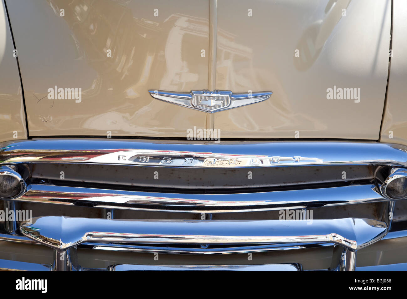 A close up detail of the front end of a 1949 Chevrolet Styleline Deluxe Convertible showing the front grill and - Stock Image