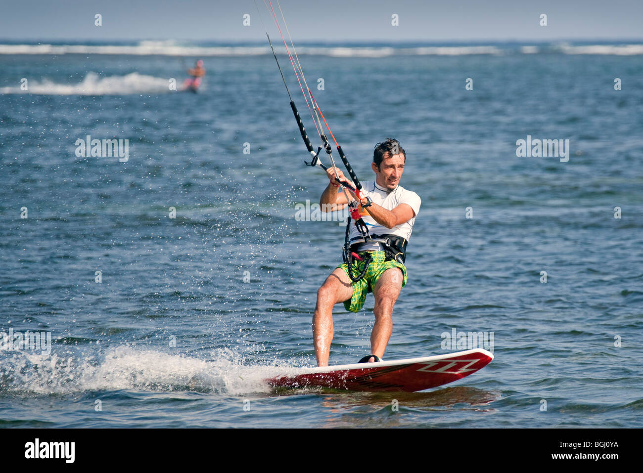 Parasurfing off sanur in Bali - Stock Image