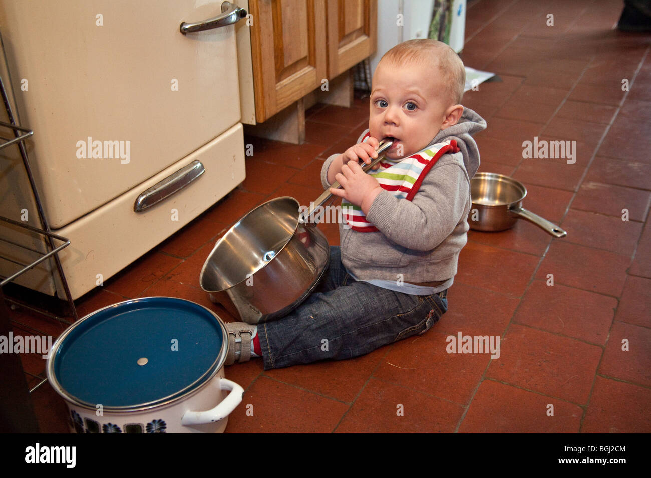 Baby Boy Eight Months Old Playing With Pots And Pans On