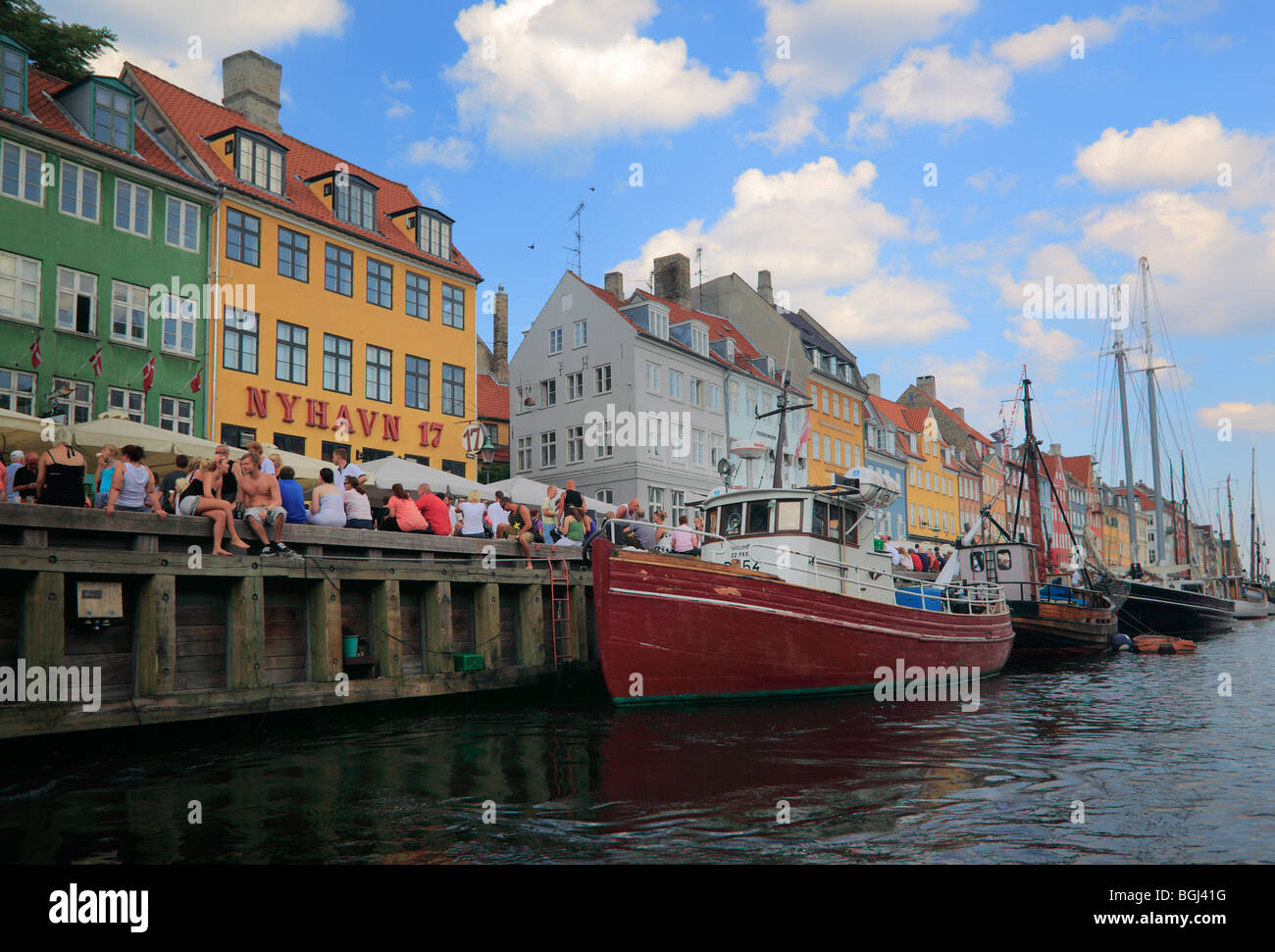 Nyhavn is a colourful 17th century waterfront, canal and popular entertainment district in Copenhagen, Denmark. - Stock Image