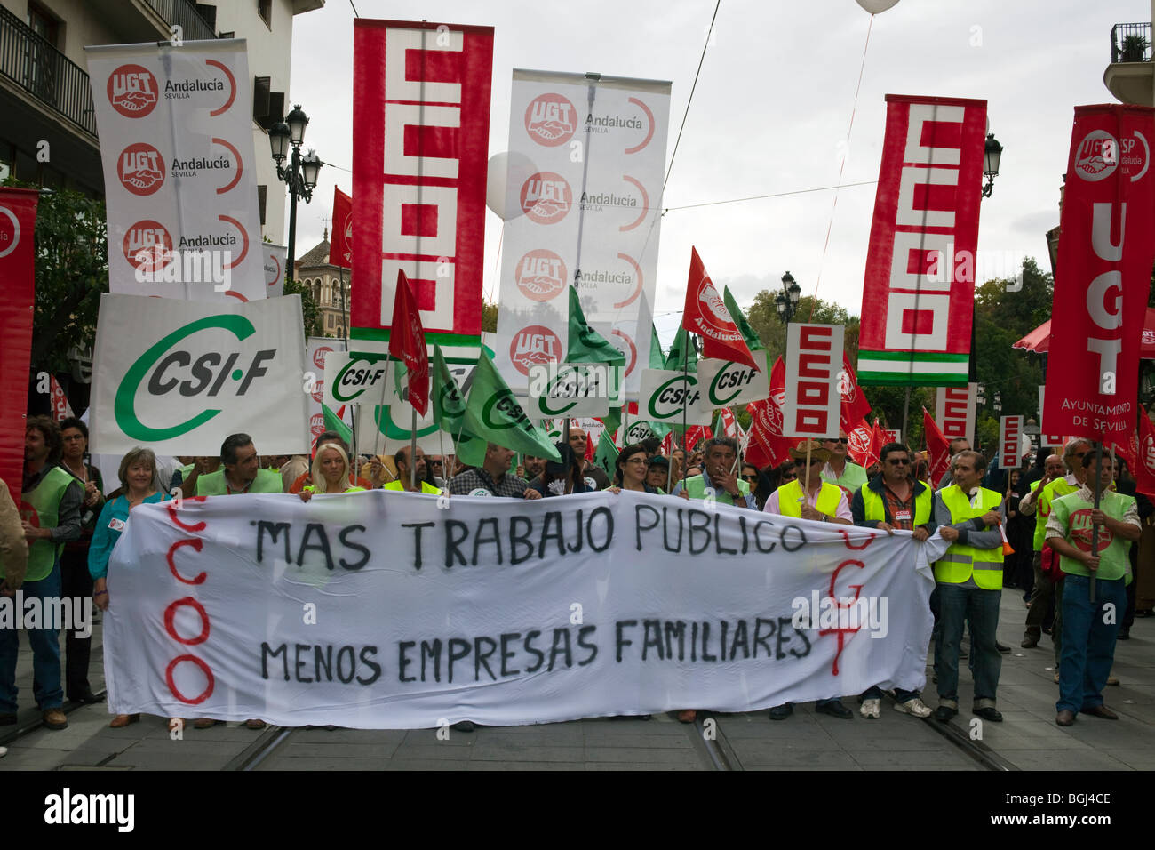 Trade unions march in Seville, Spain, protesting unemployment and asking for support for public jobs and less family - Stock Image