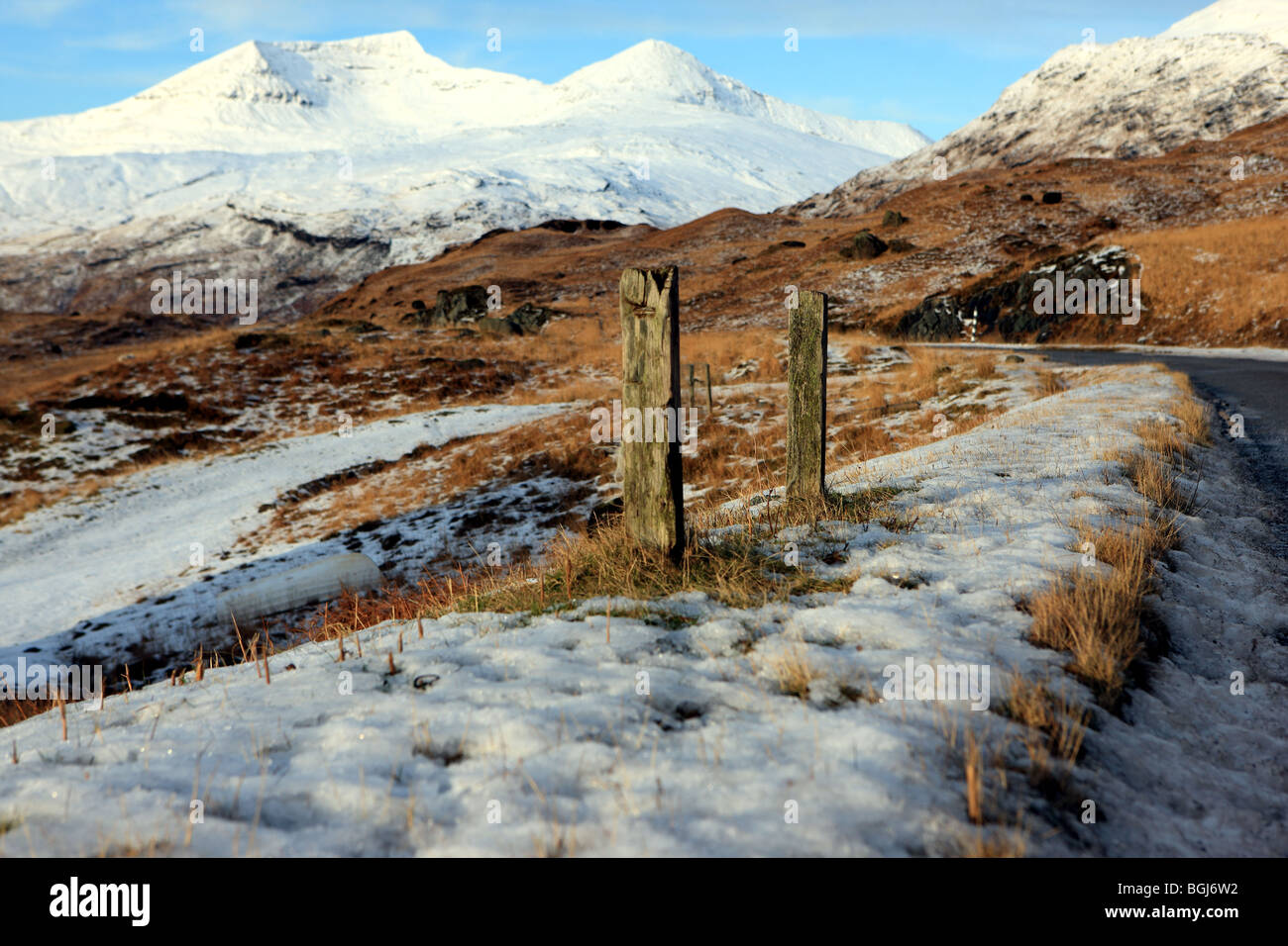 Ben More (left) on the Isle of Mull covered in snow with A'Chioch (right). - Stock Image