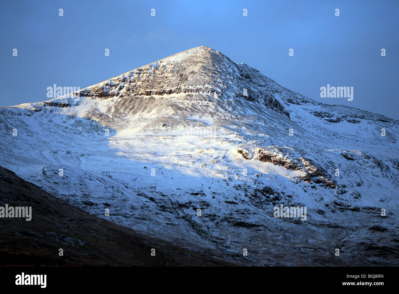 snow capped peak of Ben More on the Isle of Mull - Stock Image