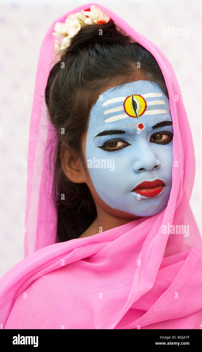 Indian girl, face painted as the Hindu god Shiva. India - Stock Image