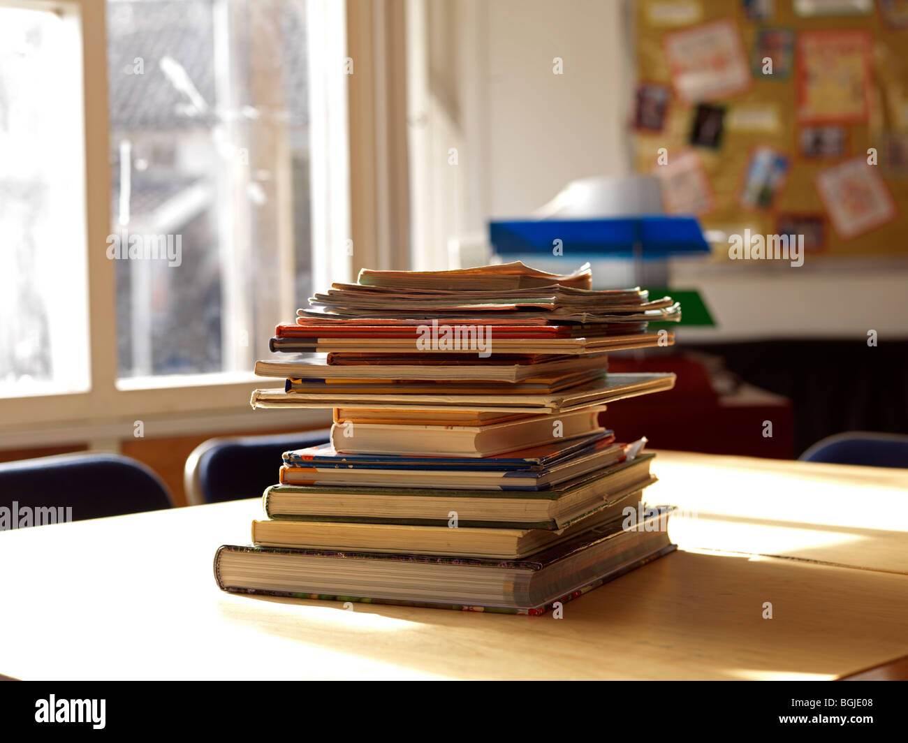 pile of books in classroom - Stock Image