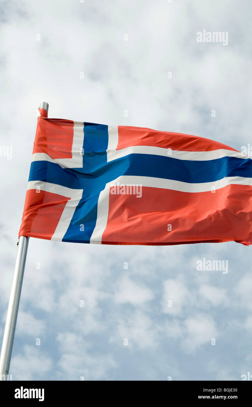 Norwegian Norway norge  flag flags pole national identity flutter fluttering in the breeze wind flagpole countryNorwegian - Stock Image