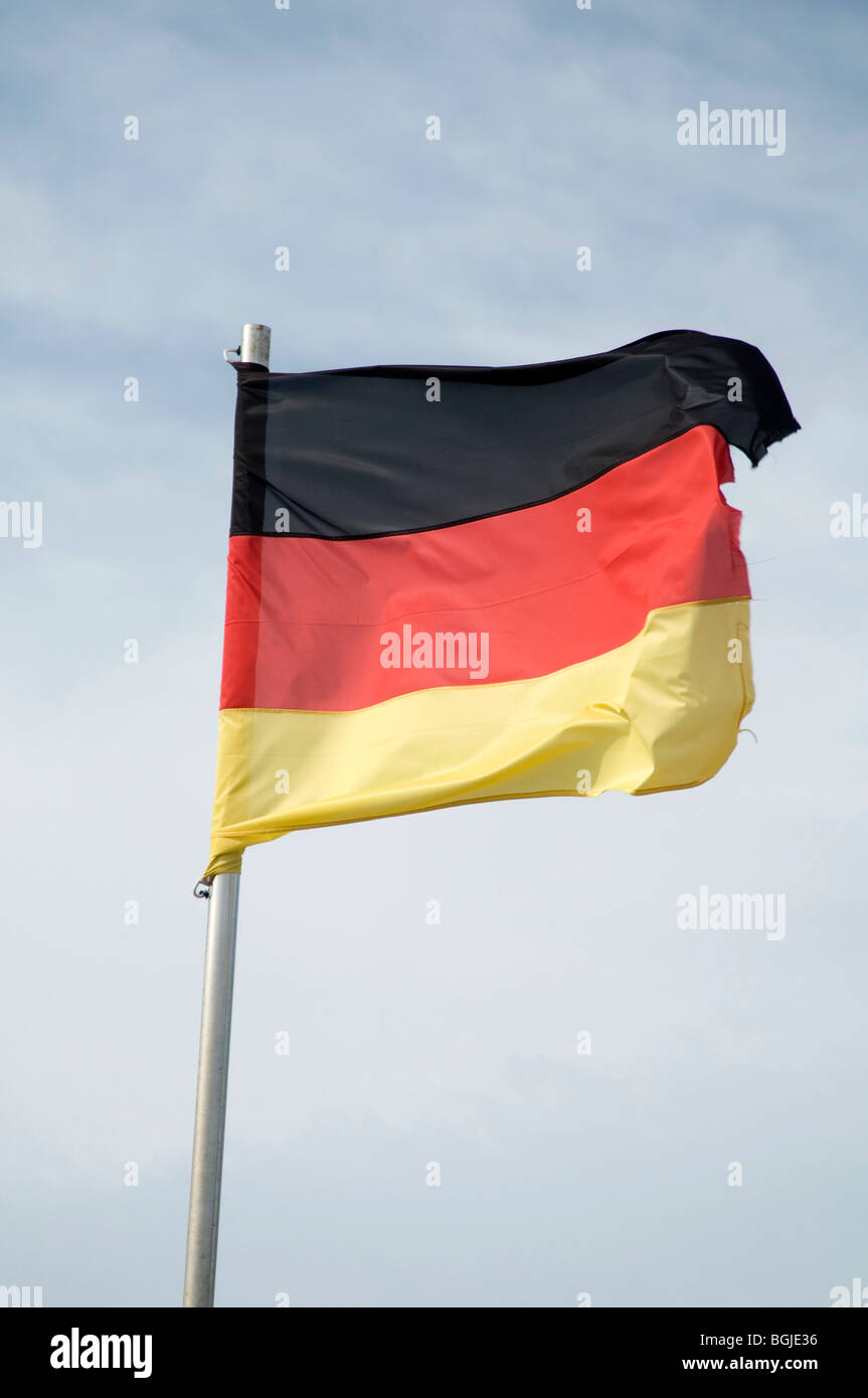 deutschland deutsch flag flags pole national identity flutter fluttering in the breeze wind flagpole country - Stock Image