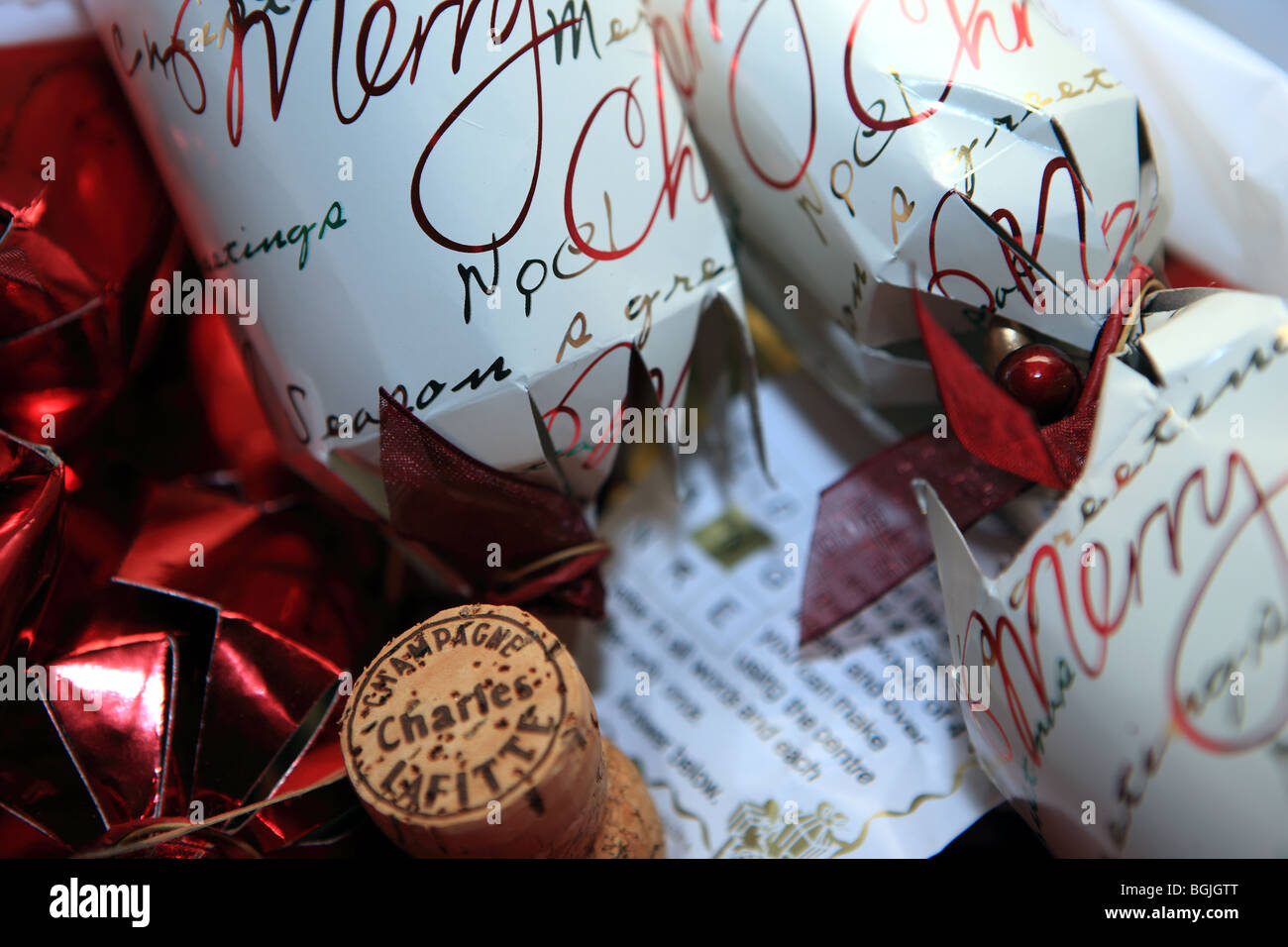 Christmas cleanup used crackers and champagne cork rubbish - Stock Image