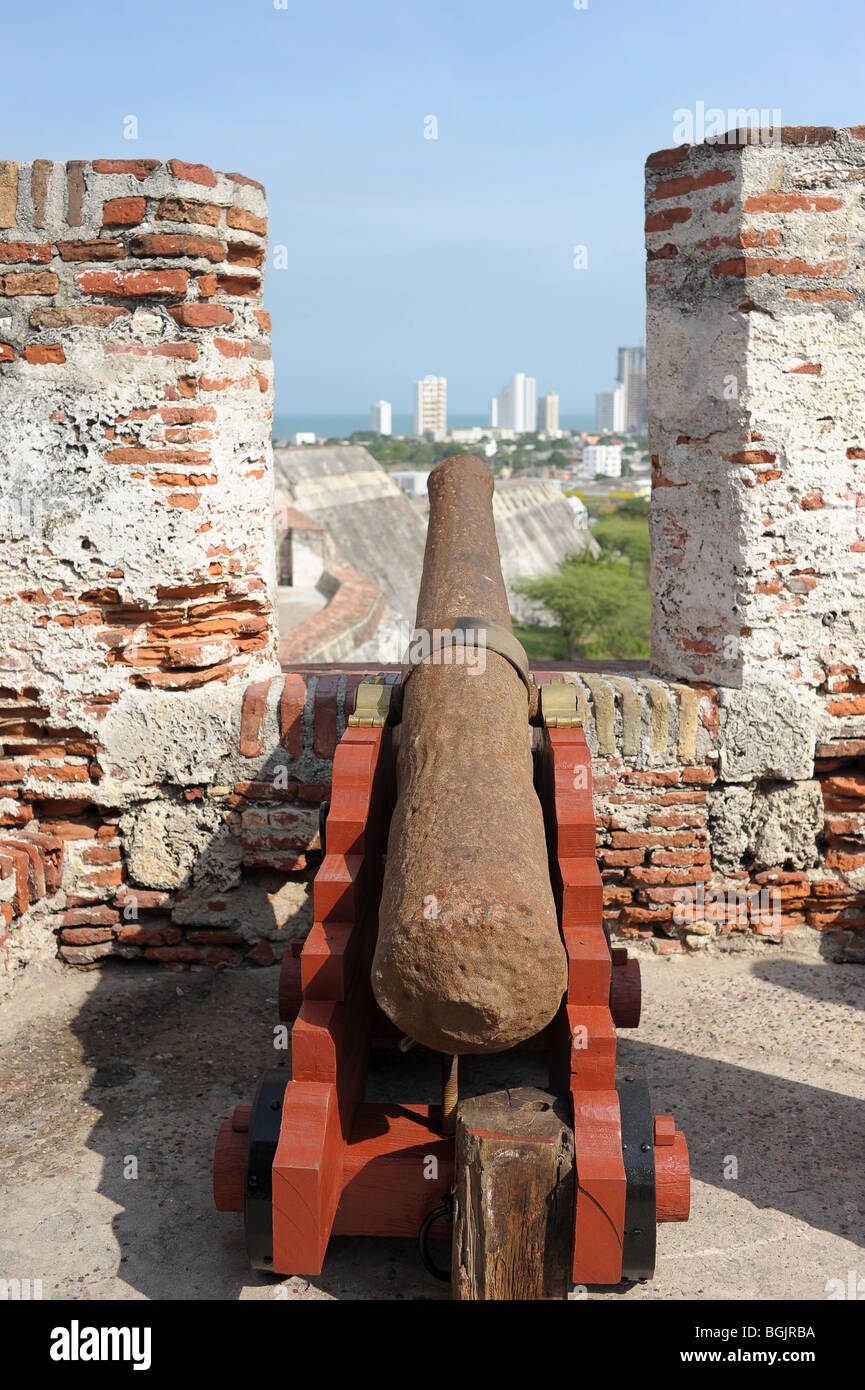 One of the fort's canons overlooking Las Murallas, thick walls built to protect the old town from enemies. Cartagena, - Stock Image