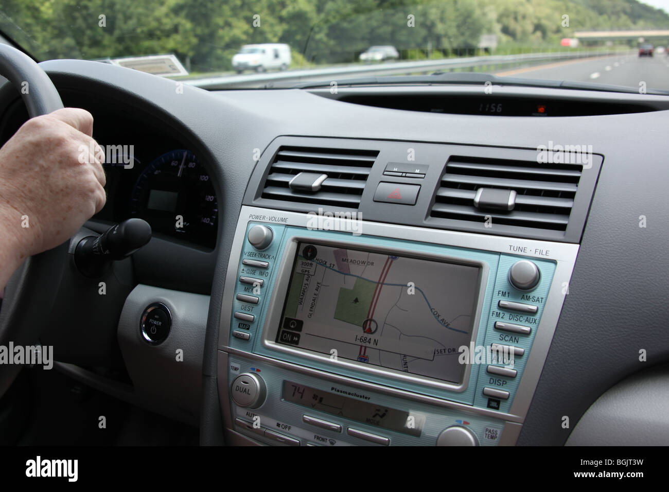 Driver uses car GPS system to navigate the roadways. - Stock Image