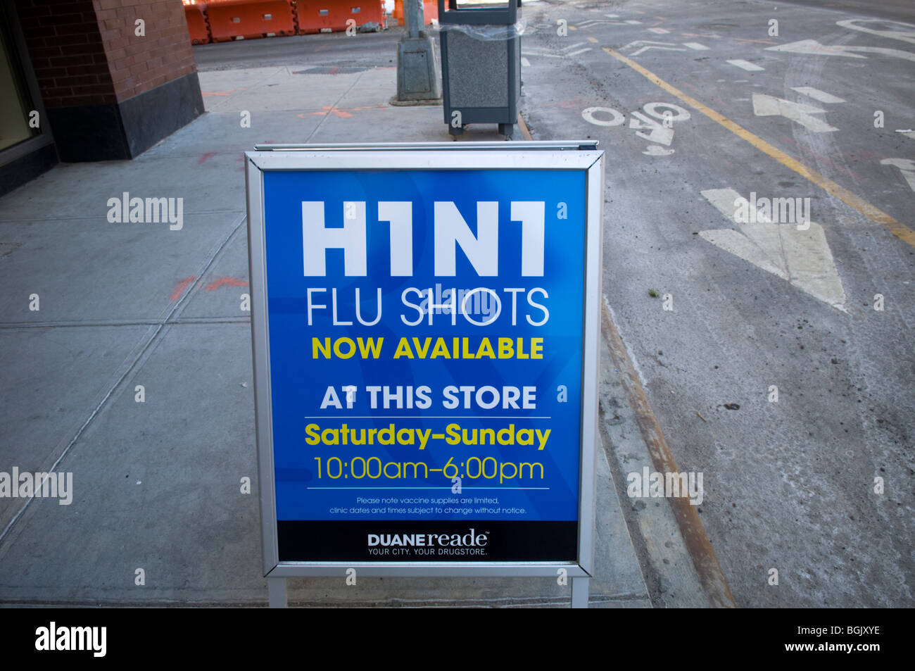 A sign saying H1N1 flu shots available outside a pharmacy in the Brooklyn neighborhood of Williamsburg in New York - Stock Image