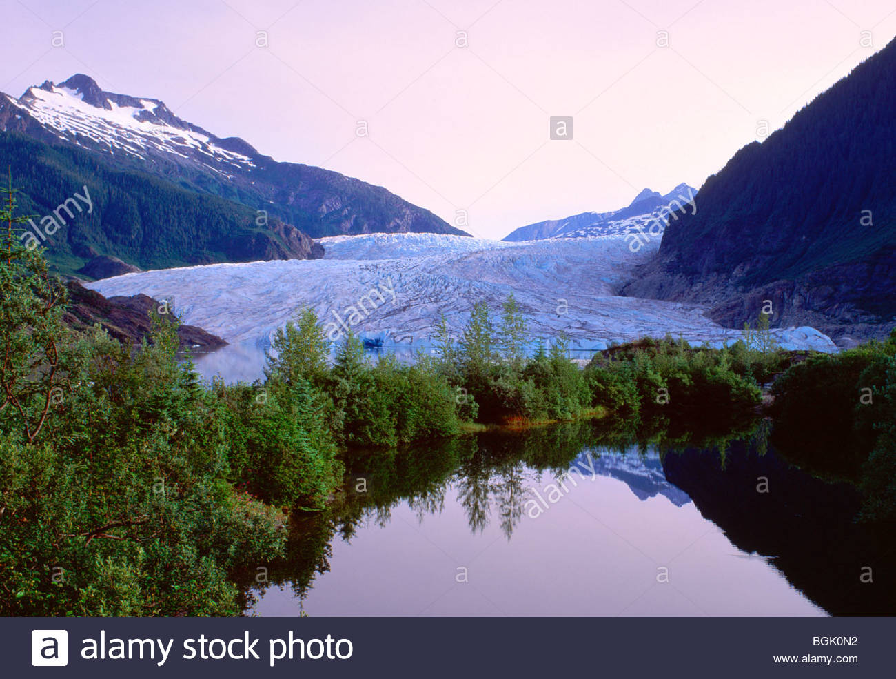 Mendenhall glacier and Mendenhall lake at sunrise in the Tongass National Forest - Stock Image