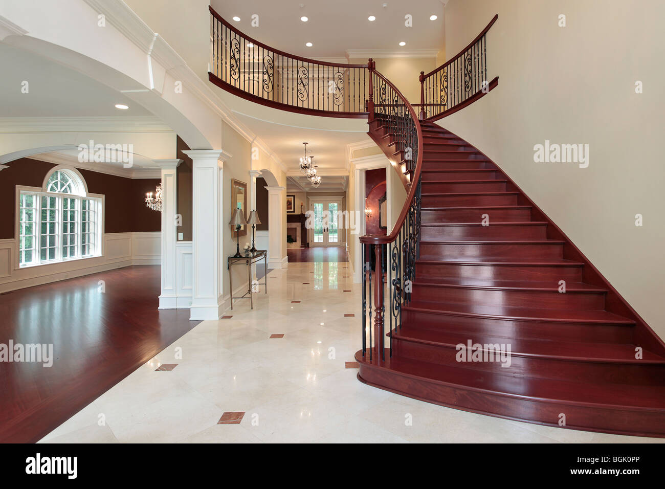 Foyer In New Construction Home With Cherry Wood Staircase ...