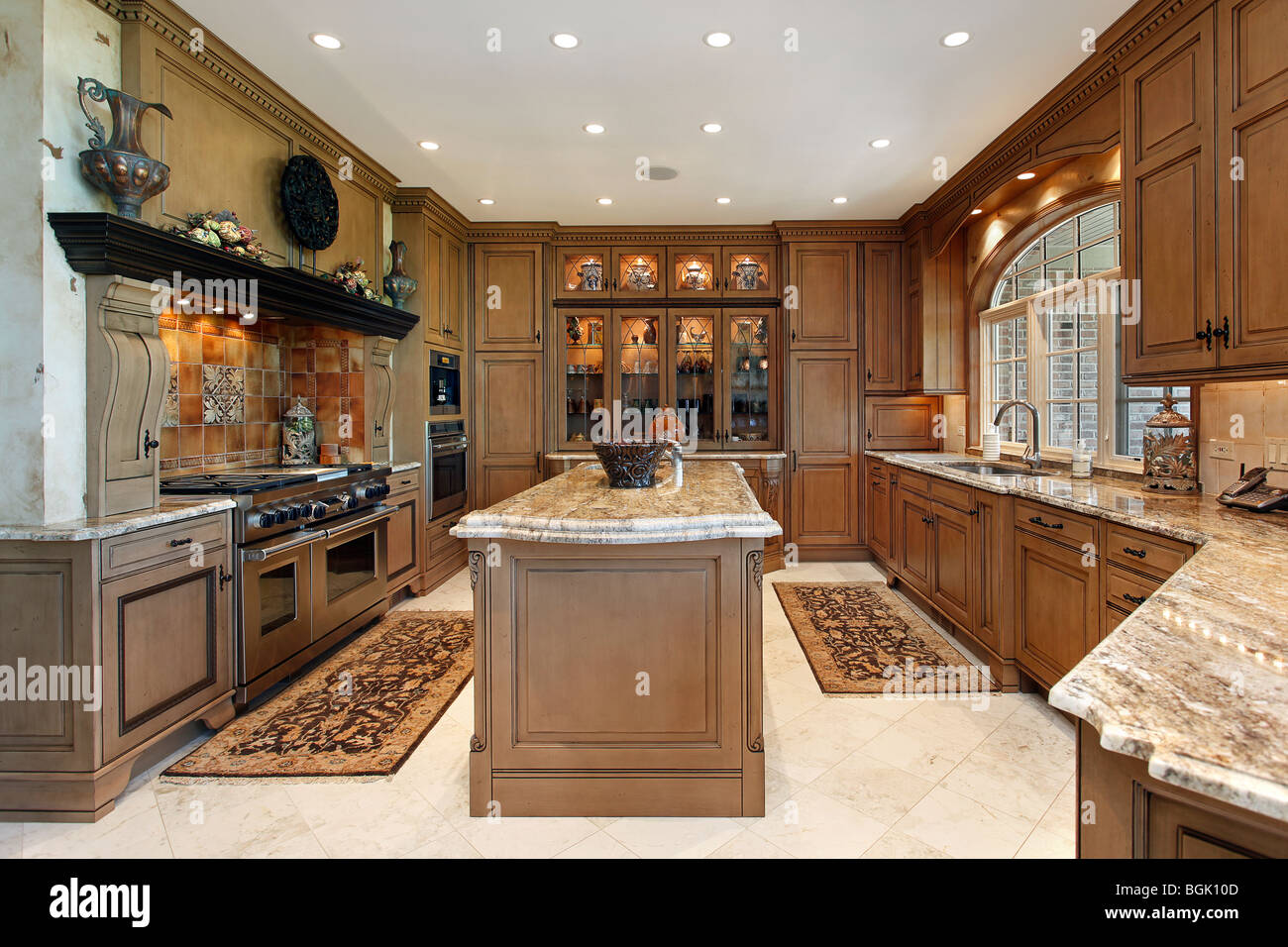 Country Kitchen In Luxury Home With Tiled Stove Backsplash Stock