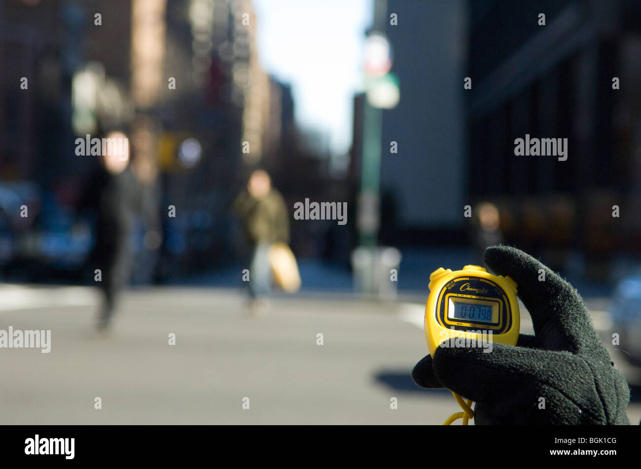 AARP volunteers survey the intersection of Third Avenue and 49th street for safety for older pedestrians - Stock Image