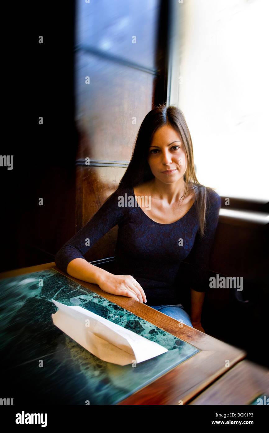 Girl in the Magenta Bar, Milan, Italy - Stock Image