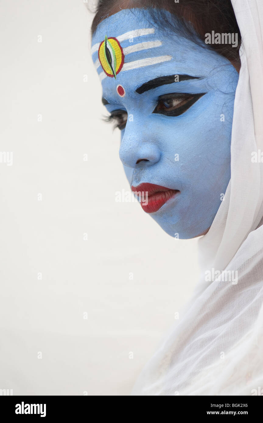 Indian girl, face painted as the Hindu god Shiva. India - Stock Image