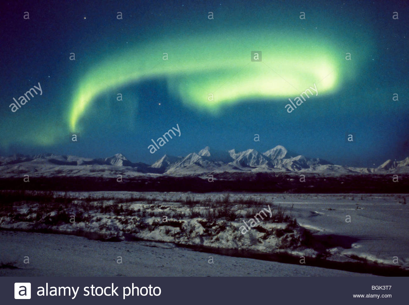 Alaska, Big Delta. The comet Hale-Bopp shines brightly through northern lights over the Delta River. Stock Photo