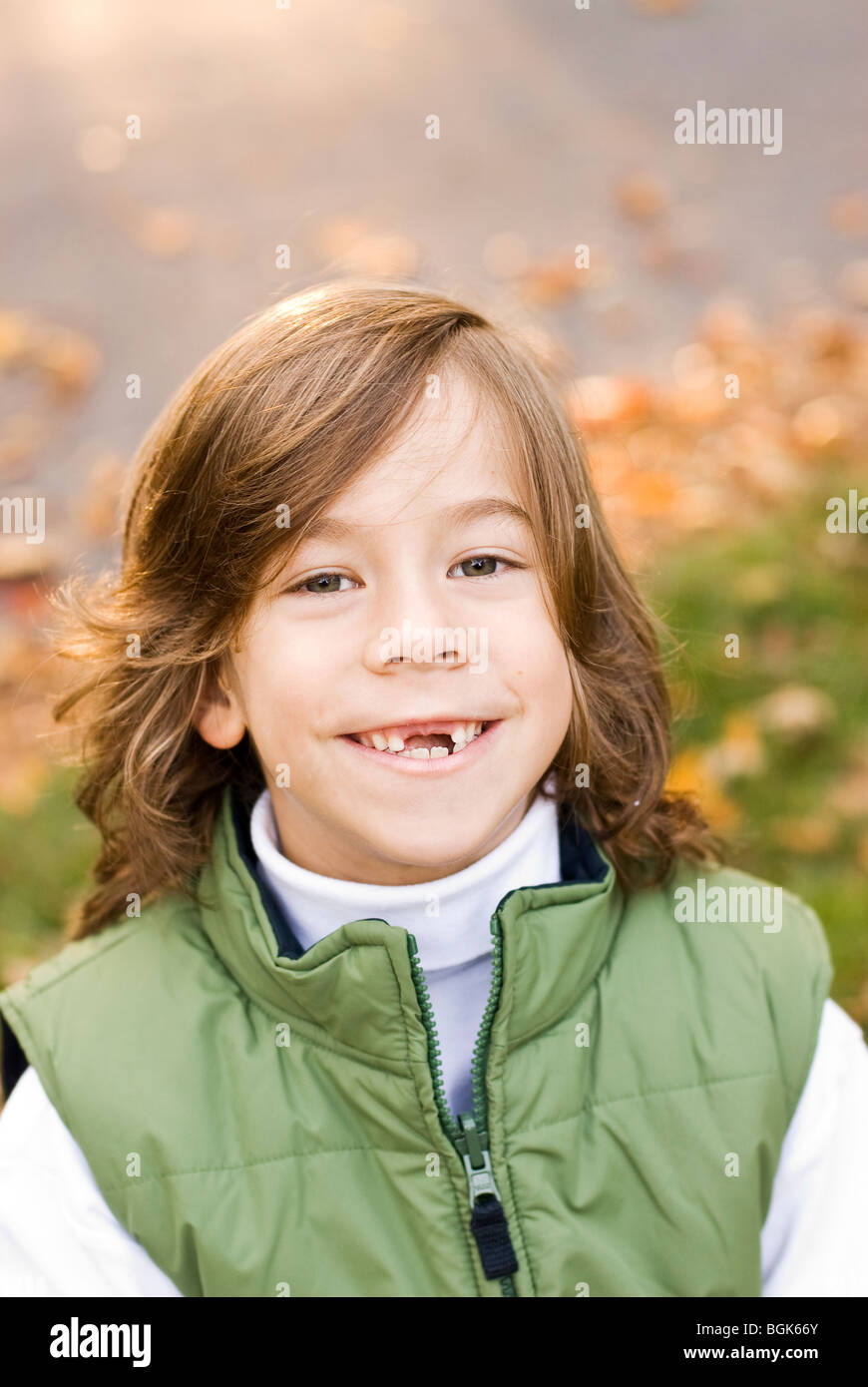 boy with missing teeth smiling - Stock Image