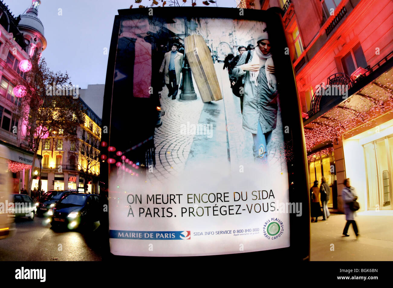 PARIS, France - Advertising Poster, health Campaign of Paris Mayor to Fight AIDS, on Street in front of Printemps - Stock Image