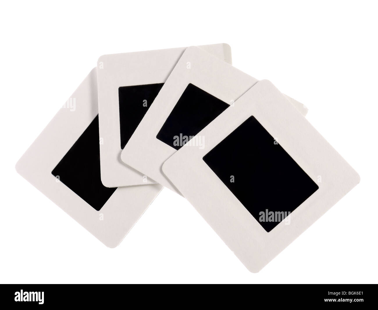 Four blank 35 mm slides with white borders shot on white - Stock Image