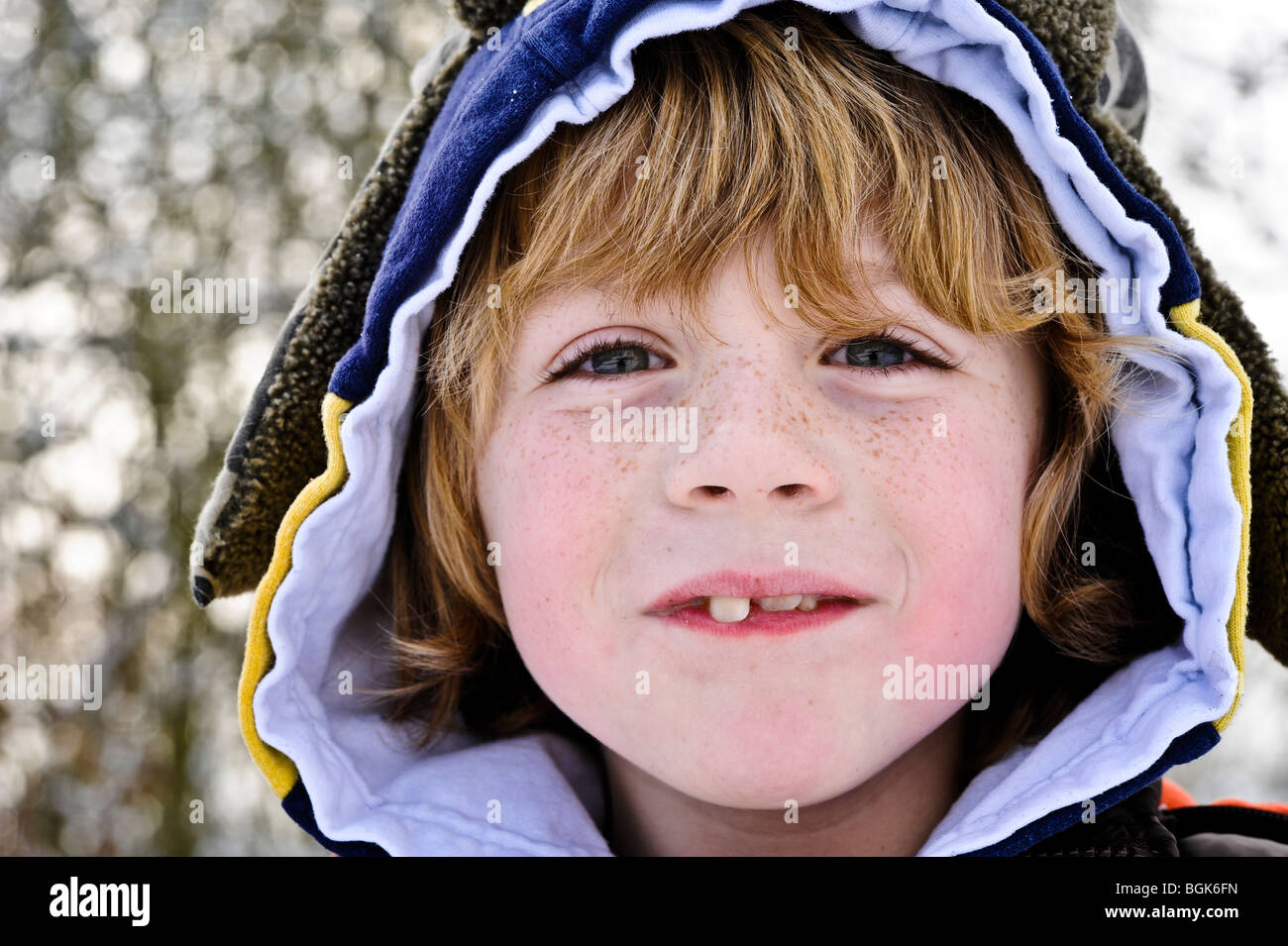 Close up of boy with hood - Stock Image