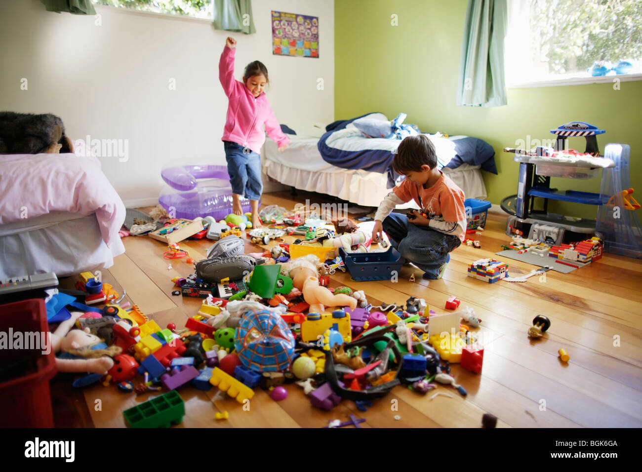 Brother and sister in their bedroom - Stock Image