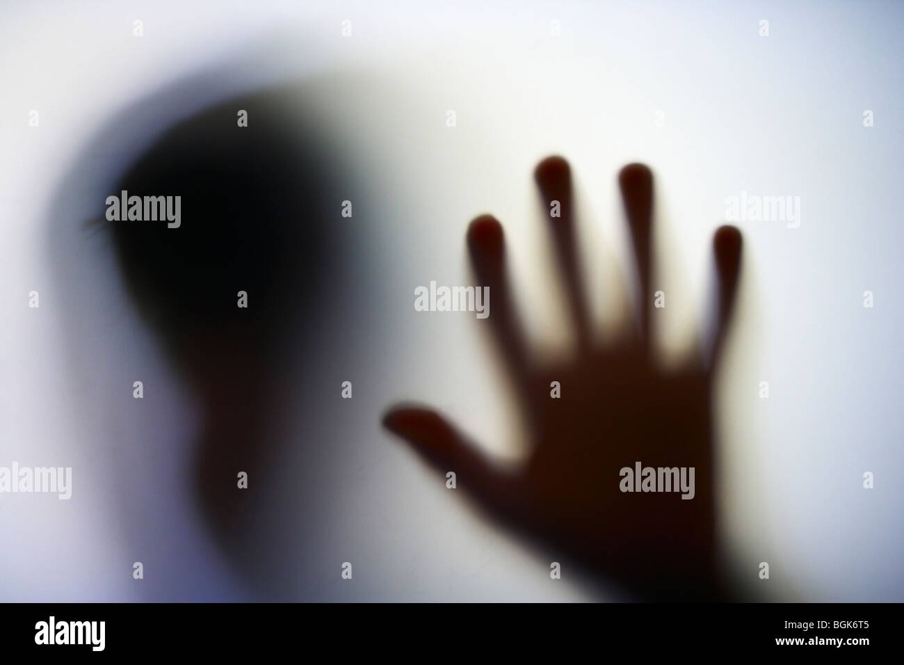 Boy through frosted glass - Stock Image