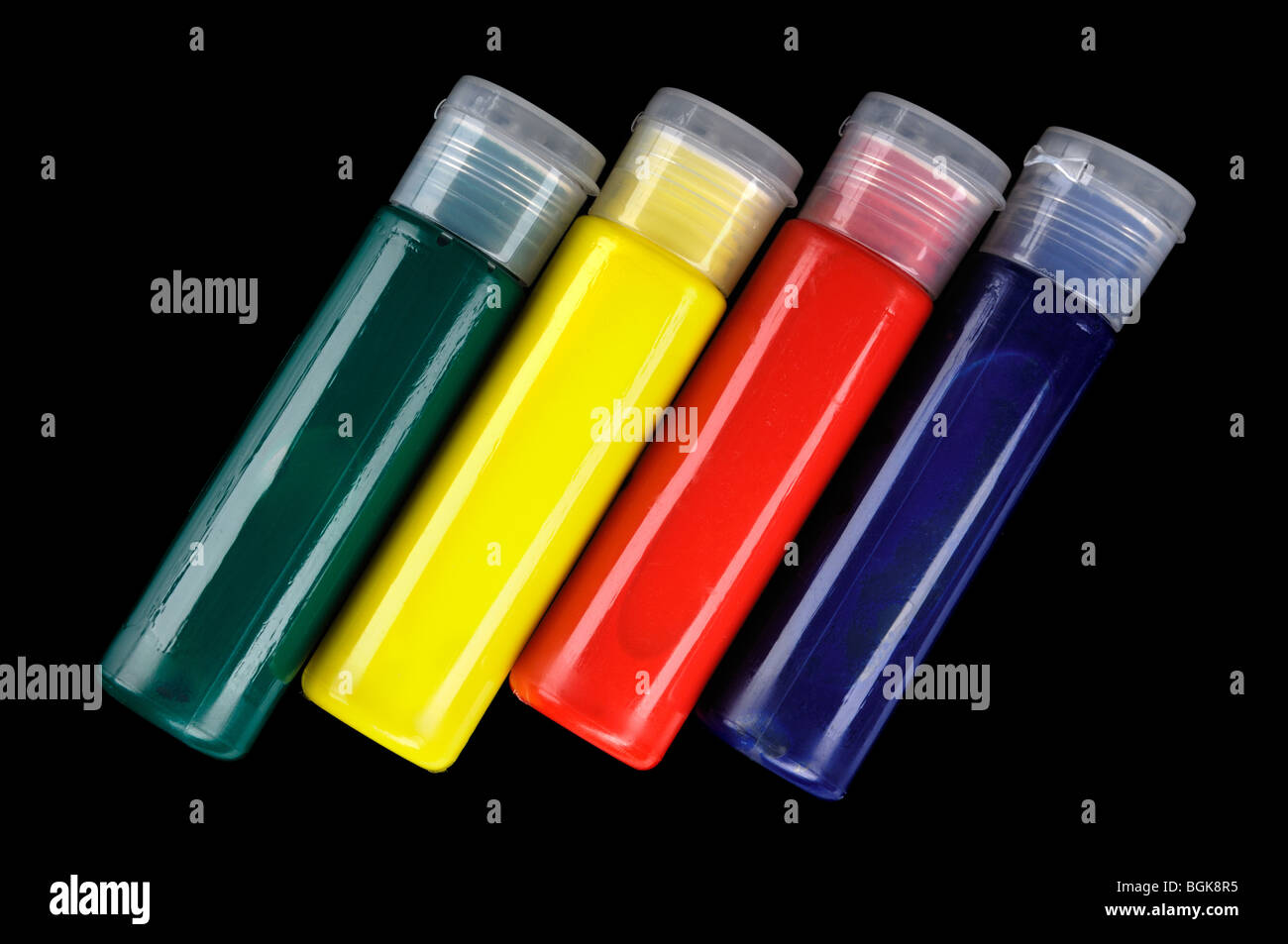 Tubes of colorful face paint isolated on black background - Stock Image