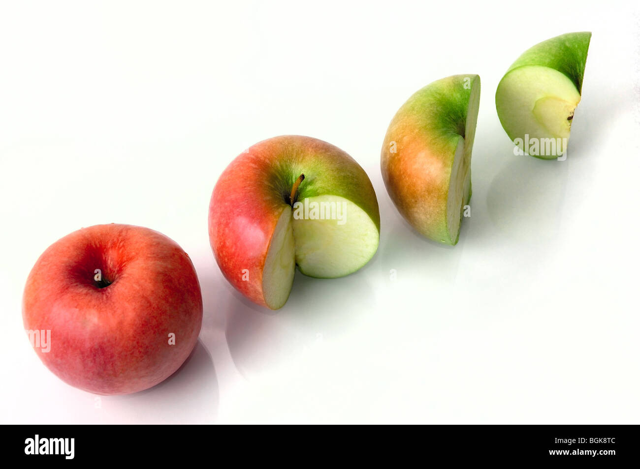Four apples from red and whole to quater of green one isolated on white background, percentage concept, profit or - Stock Image