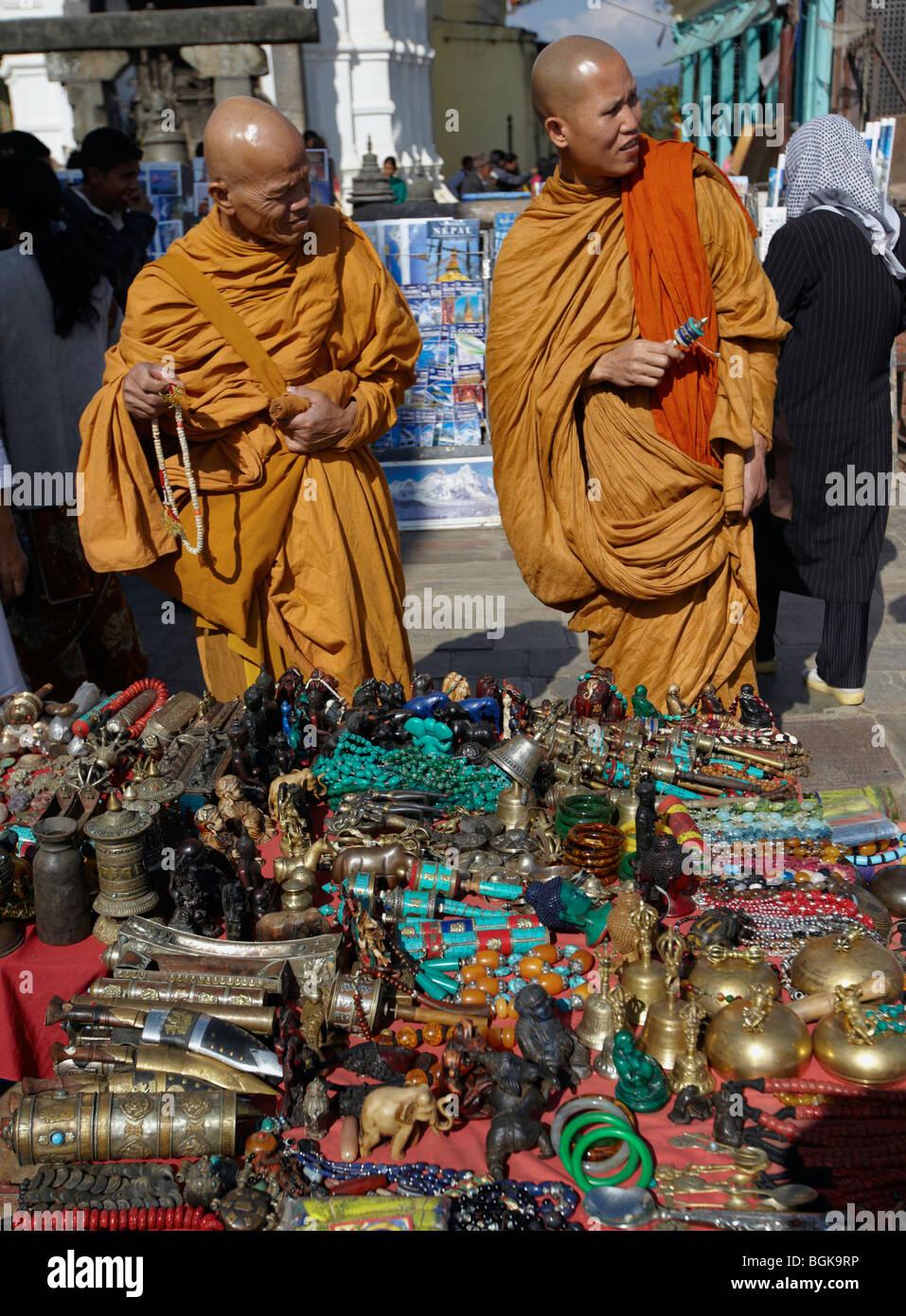 Buddhist Monks Shopping  In Durbar Square Kathmandu Nepal Asia - Stock Image