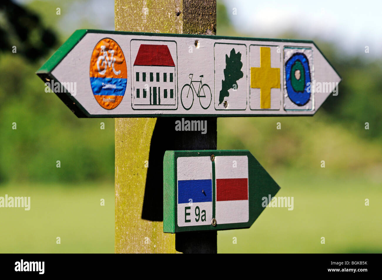 Signpost with pictograms in the palace gardens of Schloss Basedow, designed by Peter Joseph Lenne, Mecklenburg-Western - Stock Image