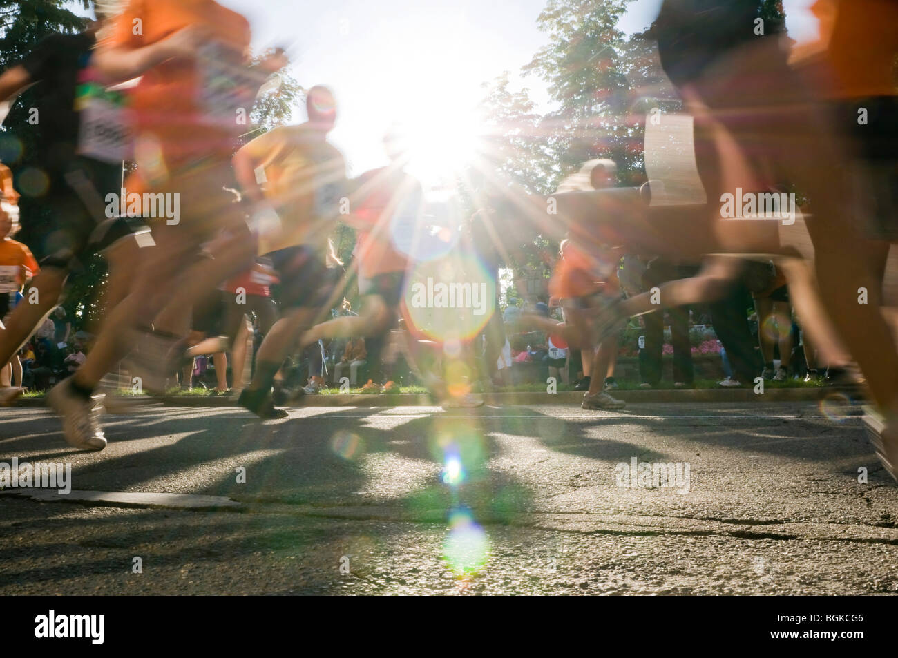 Marathon runner with backlight and motion blur - Stock Image