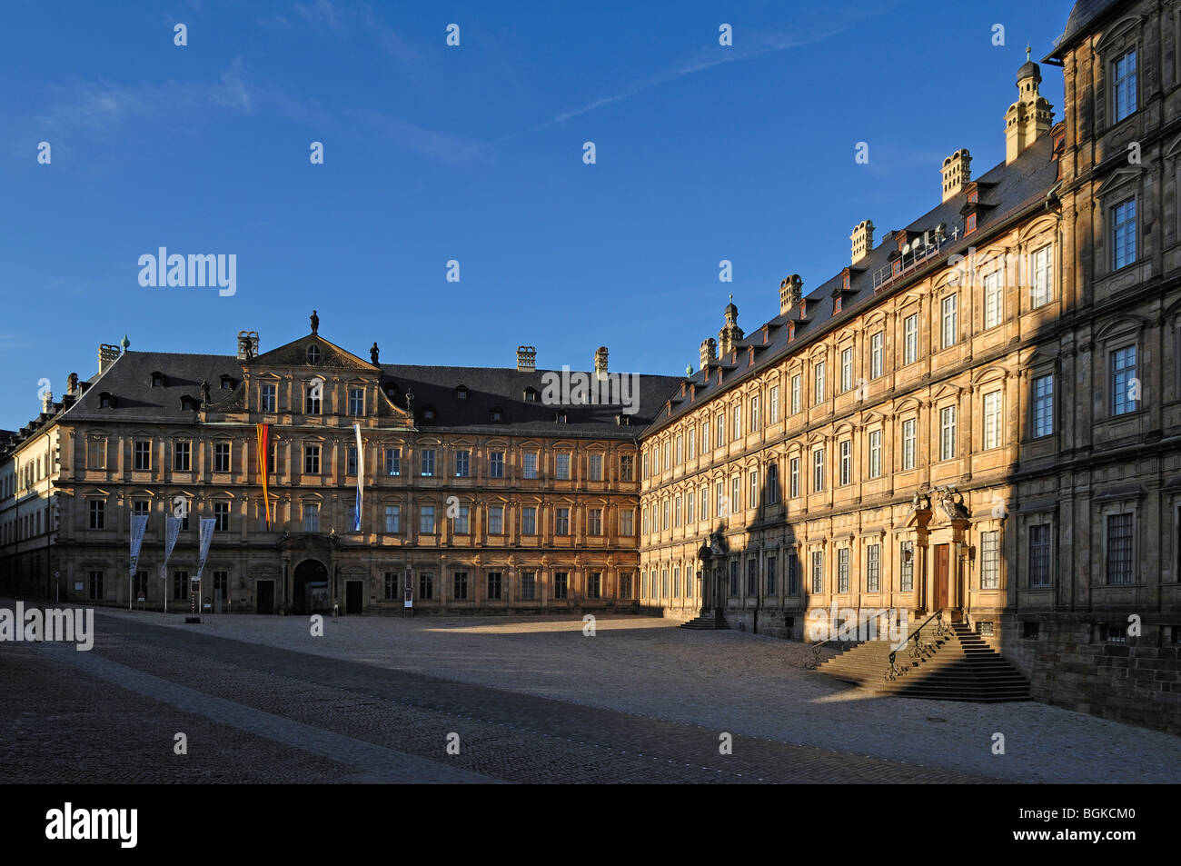 The Neue Residenz palace, Baroque, built from 1697 to 1703, with Domplatz square in the late evening light, Domplatz - Stock Image