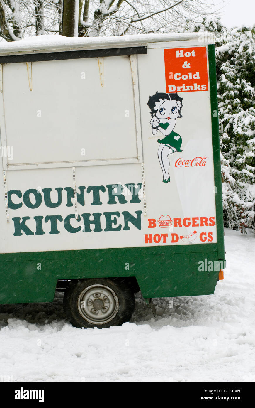 A snowed-in burger van in a side street in Brighton. - Stock Image
