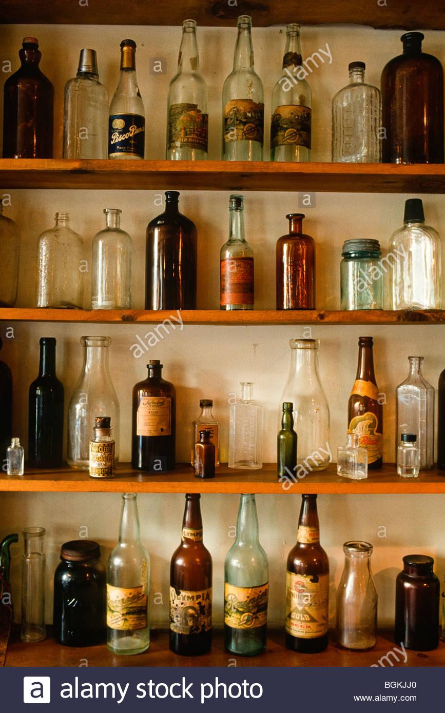 Alaska, McCarthy. Old bottles at McCarthy Lodge, in Wrangell-St. Elias National Park. - Stock Image