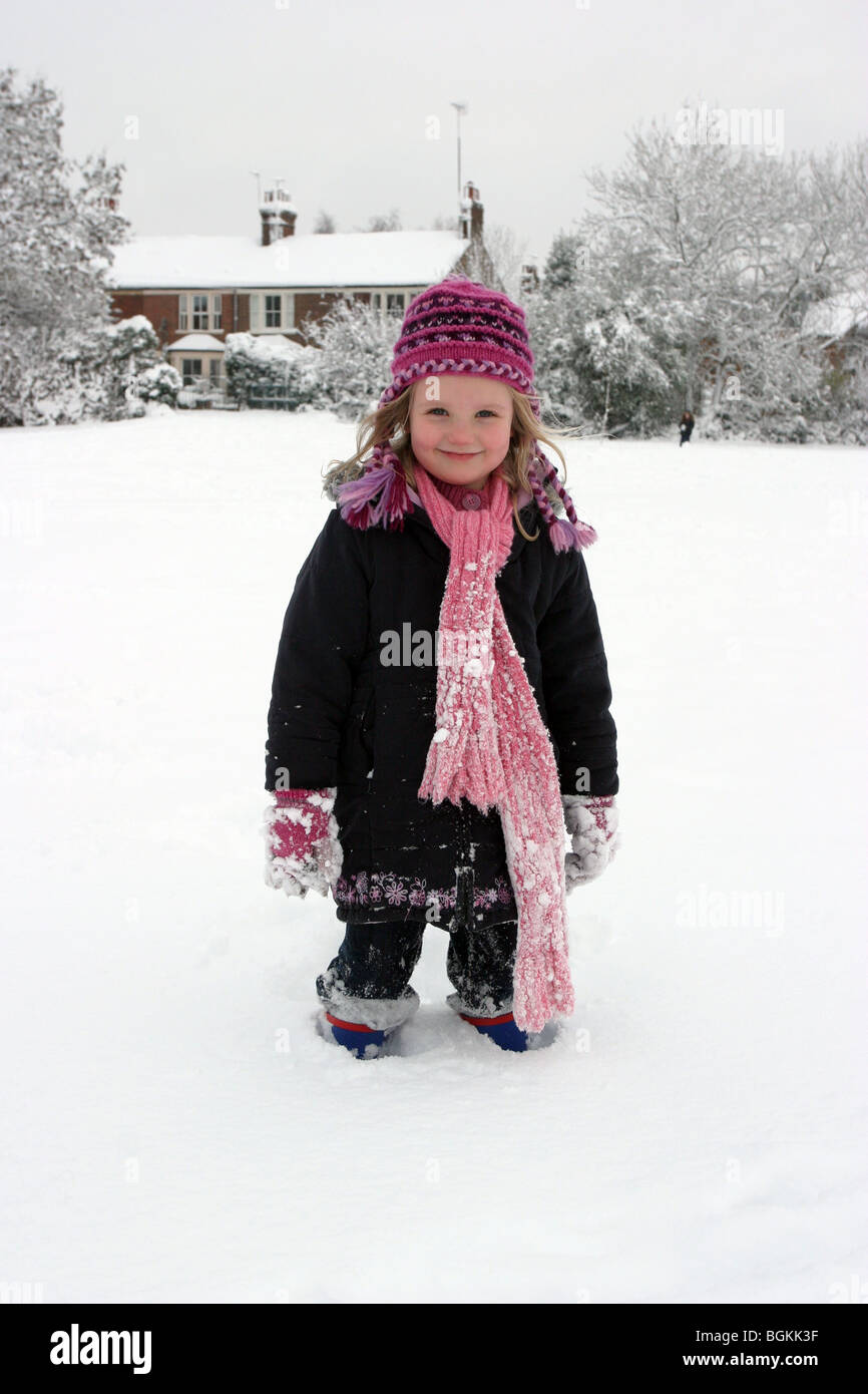 Young Girl standing in deep snow - Stock Image