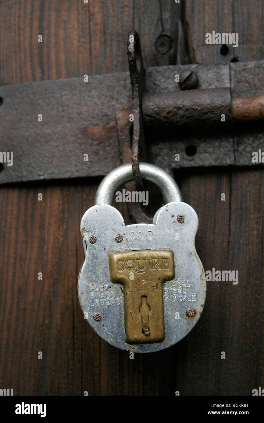 Squire Padlock On An Old Wooden Door - Stock Image