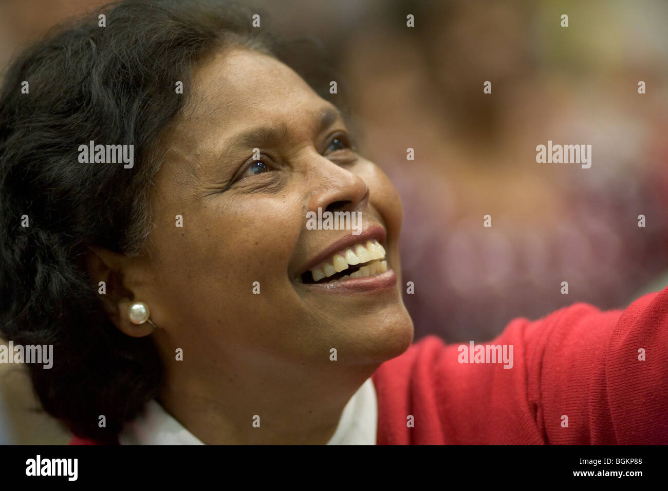 Woman gives thanks to God at rally organised by Cor Lumen Christi Community London uk Stock Photo