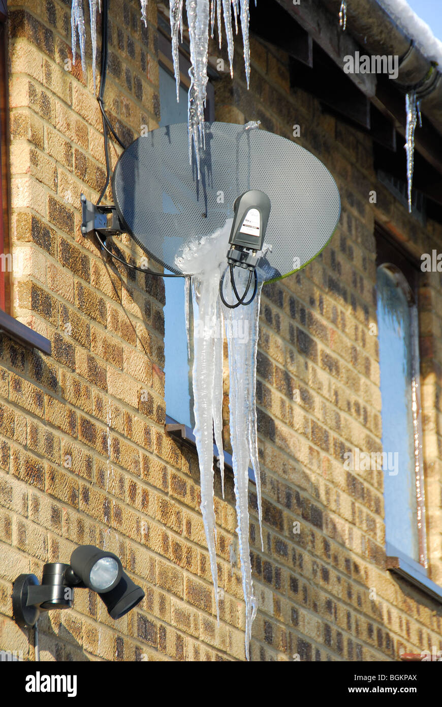 A satellite dish with icicles. UK, 2010. - Stock Image