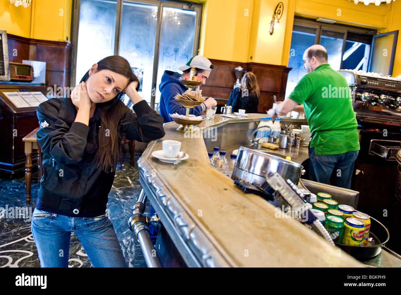 Young woman at bar, Milan, Italy - Stock Image