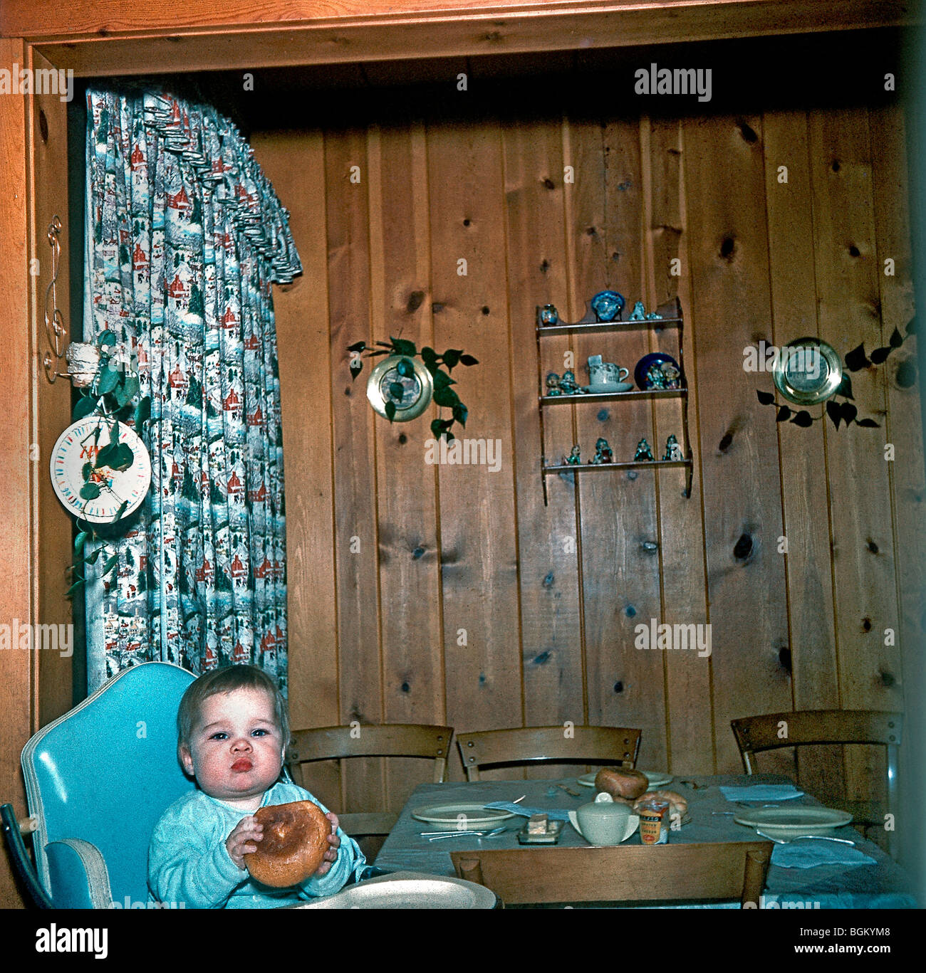 N.J, U.S.A., 1950's Family Photos, Young Girl Alone at Home in Kitchen, Suburbs.'Old Family Photos' - Stock Image