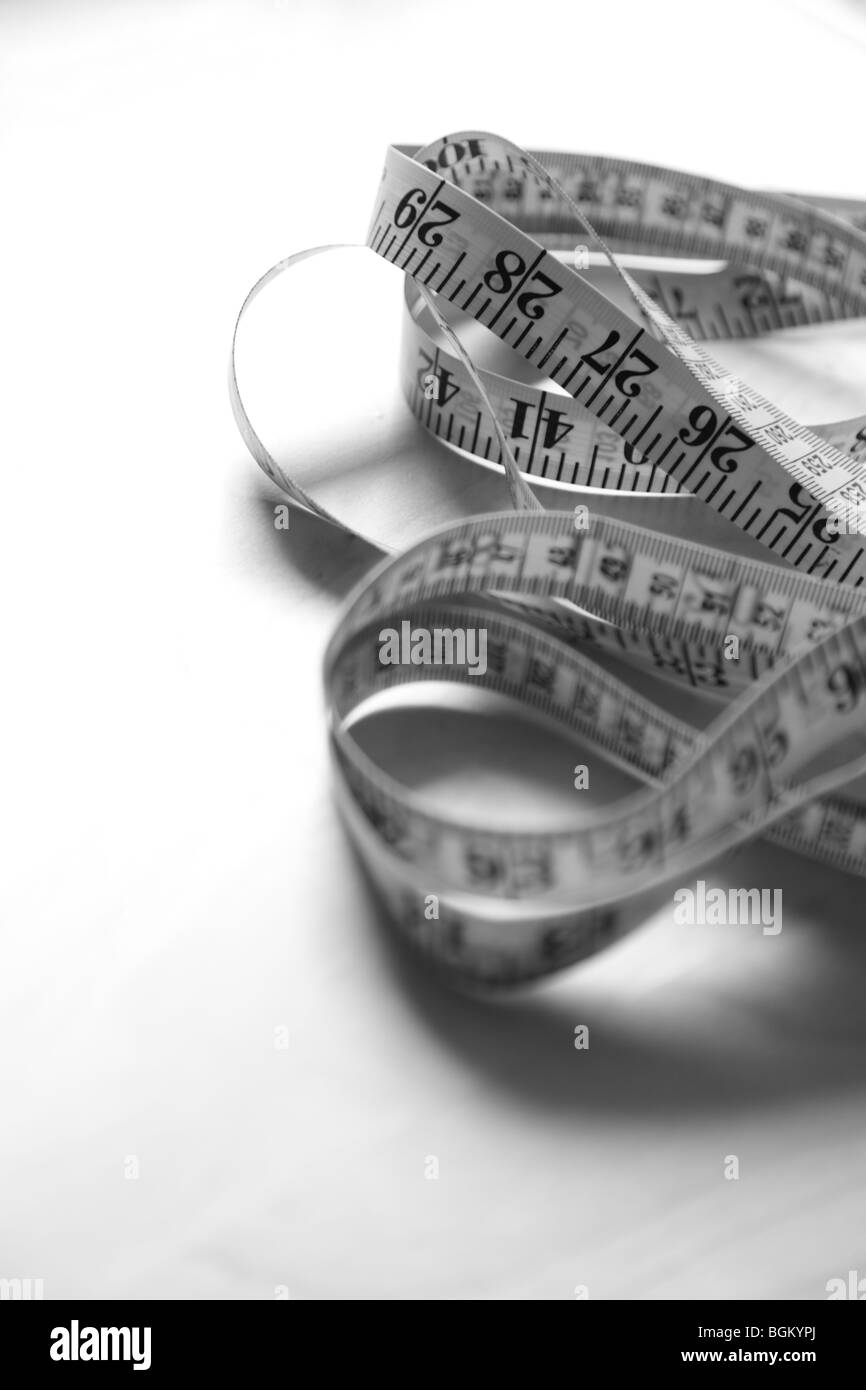 Close up of tape measure in black and white - Stock Image