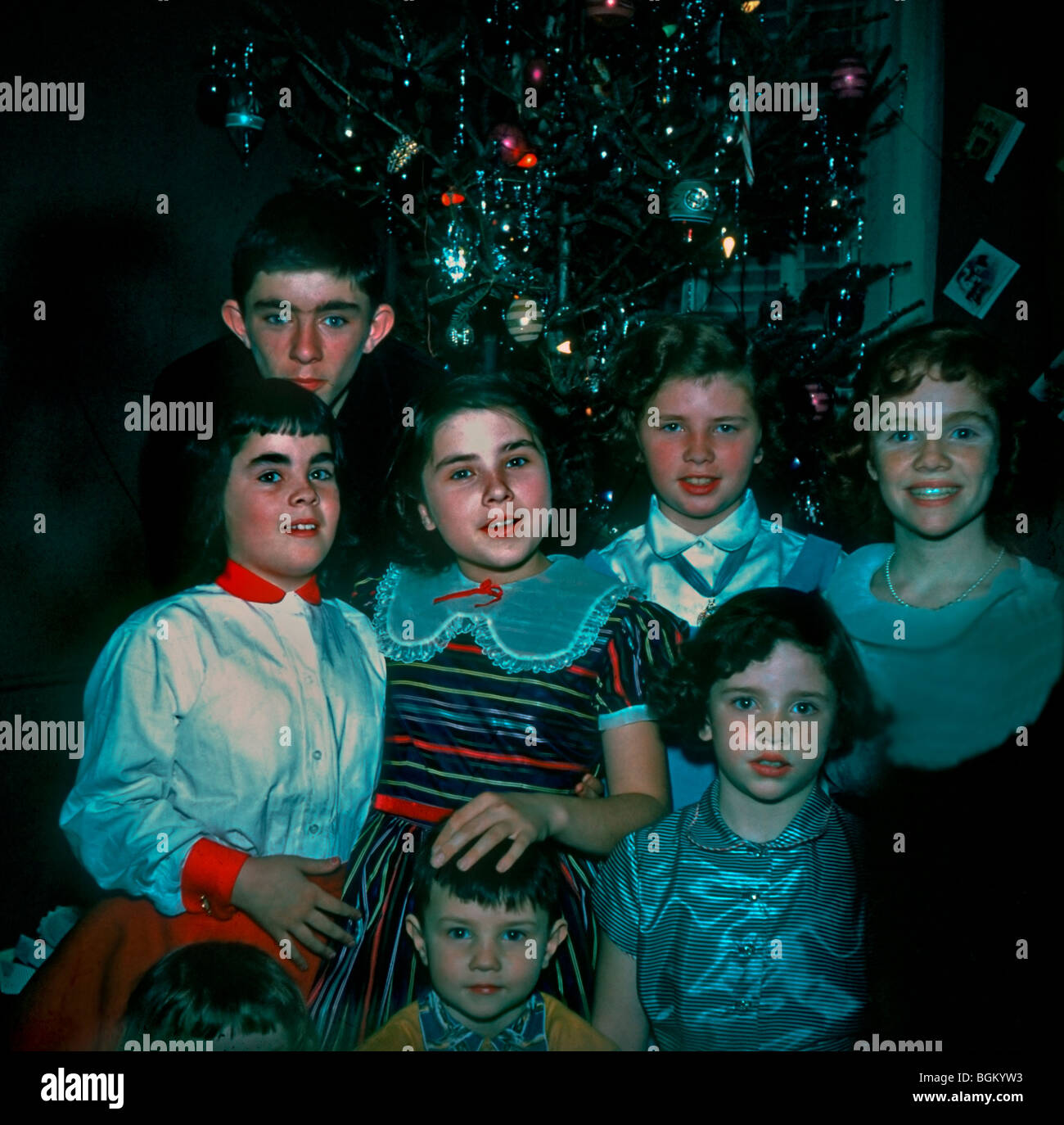 1950's Family Photo, 7 Children Posing for Portrait on Christmas Day at Home in Living Room. 'Old Family - Stock Image