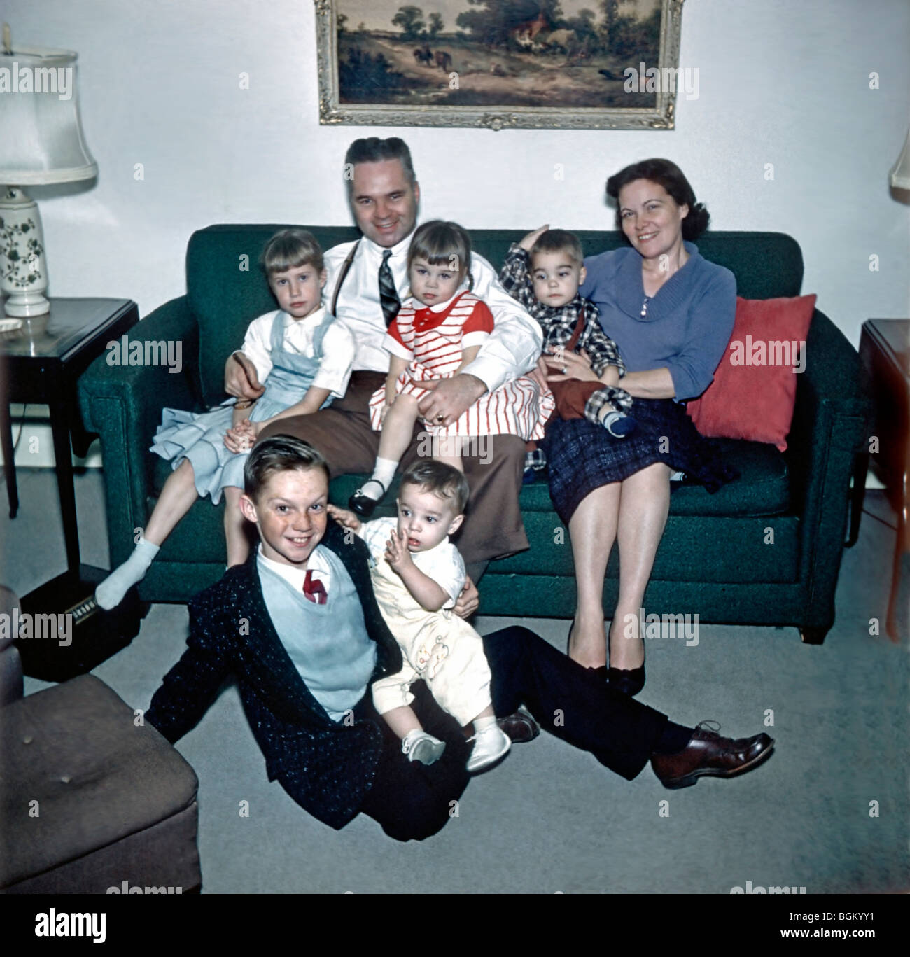 Family Archives Photo. Large Family Portrait 1950s 'Old Family Photos' Group sitting on Couch in Living - Stock Image