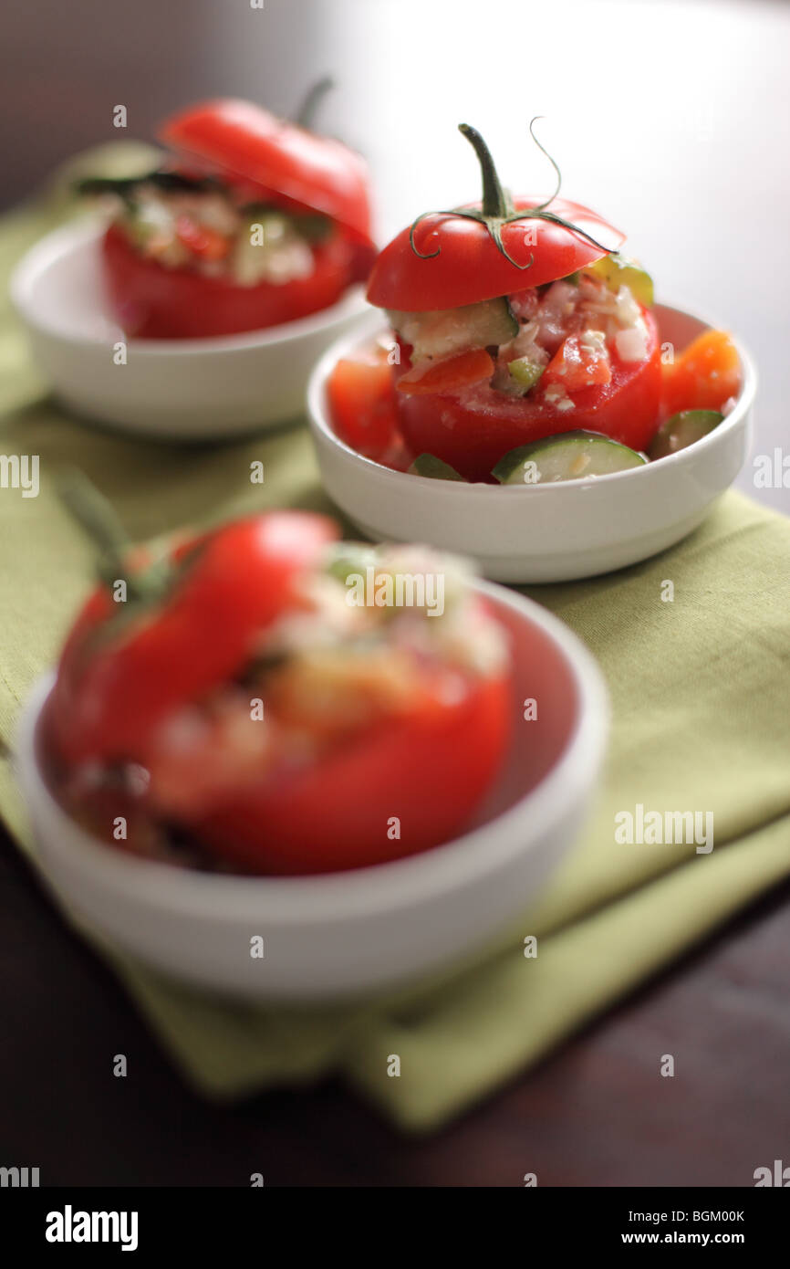 Tomatoes stuffed with salad - Stock Image