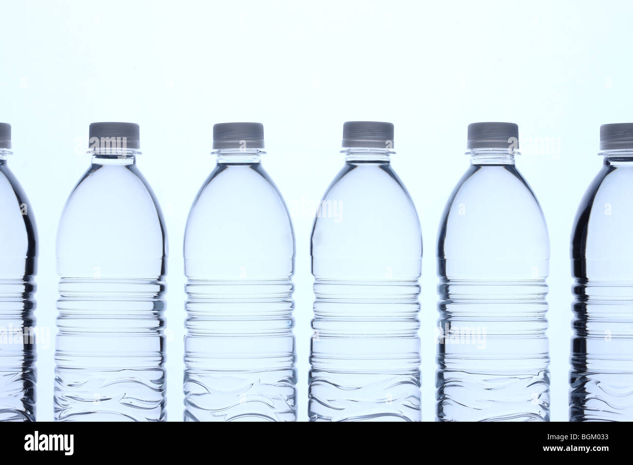 Bottles of water in row - Stock Image