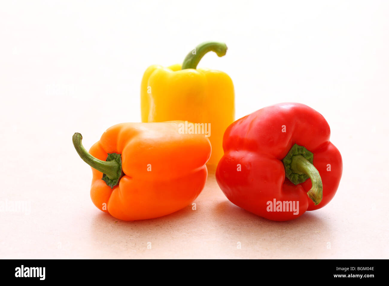 Multi colored bell peppers - Stock Image