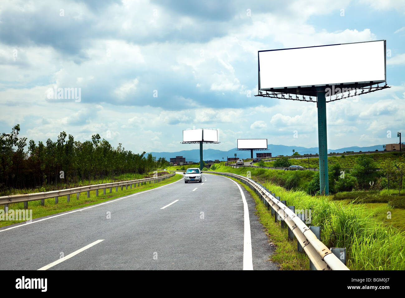 the billboard ande road outdoor. - Stock Image